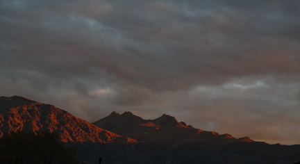 """Arrowtown Mountain Sunset"", Canon G10. 1/80 sec at f/4.5, ISO 100. Shot with a teleconverter lens."