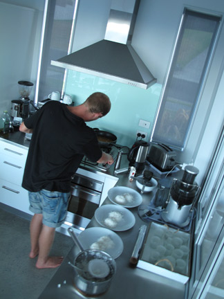 Scotty cooking up a feat at his families bach at Langs Beach