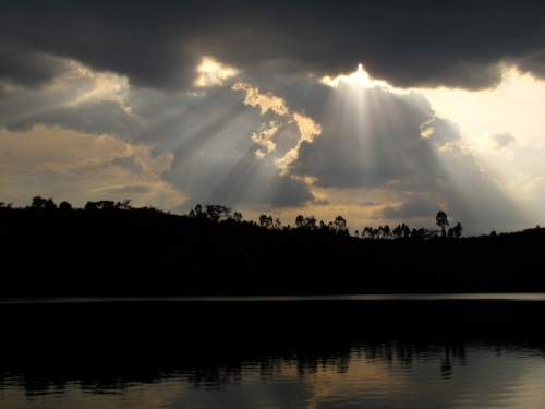 """""""The Rains Down In Africa"""" God rays over a crater lake in East Africa. Canon G10 1/1600 Sec F 4.0 ISO 80"""