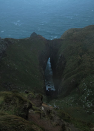 Lovers Leap looking down at sea cave.