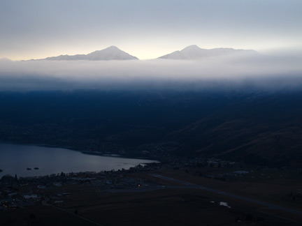 Queenstown through the clouds, guarded by peaks