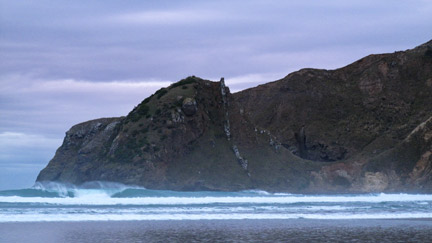 One of the smaller beach break waves at the cove