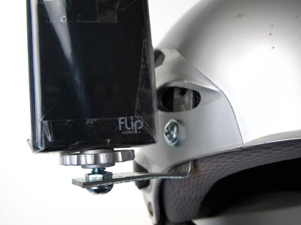 The nut and bolt attachment point on the helmet allows the L bracket to pivot when loosened for a quick pitch adjustment of the camera.