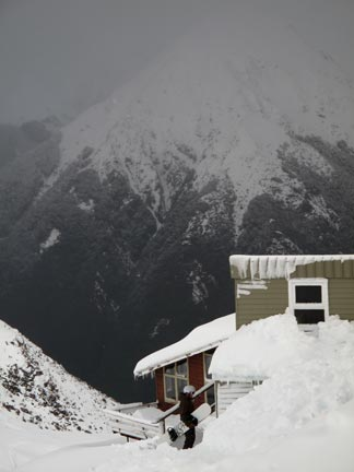 Looking back at Ski Patrol, the goods lift shed, and the valley from the lodge.