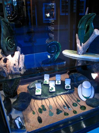Window Display with Jade Pendants, Sculptures and Shell Jewelry.