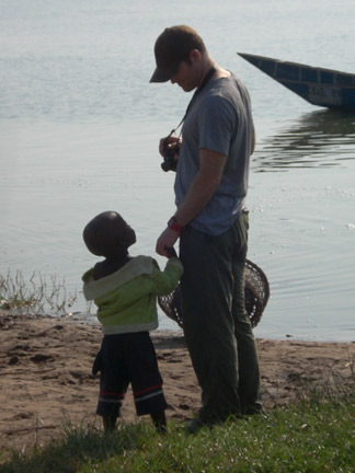As I was taking pictures of the hippos, my friend here came up and grabbed my finger, he wouldn't let go.  He has the largest head, he is going to be a large human.  I feel sorry for his mom.